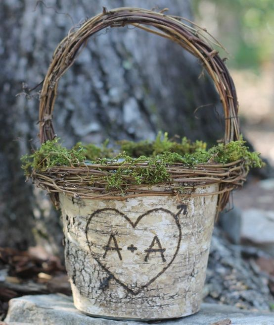 a bark, vine and moss flower girl basket is a cool idea for a rustic or woodland wedding
