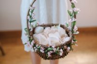 a basket decorated with pink blooms is a classic option, looks very cute with pink petals
