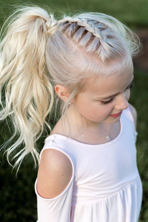 a beautiful wavy high ponytail with braids on top and a bit of mess is a lovely idea for a rustic, casual or boho flower girl look