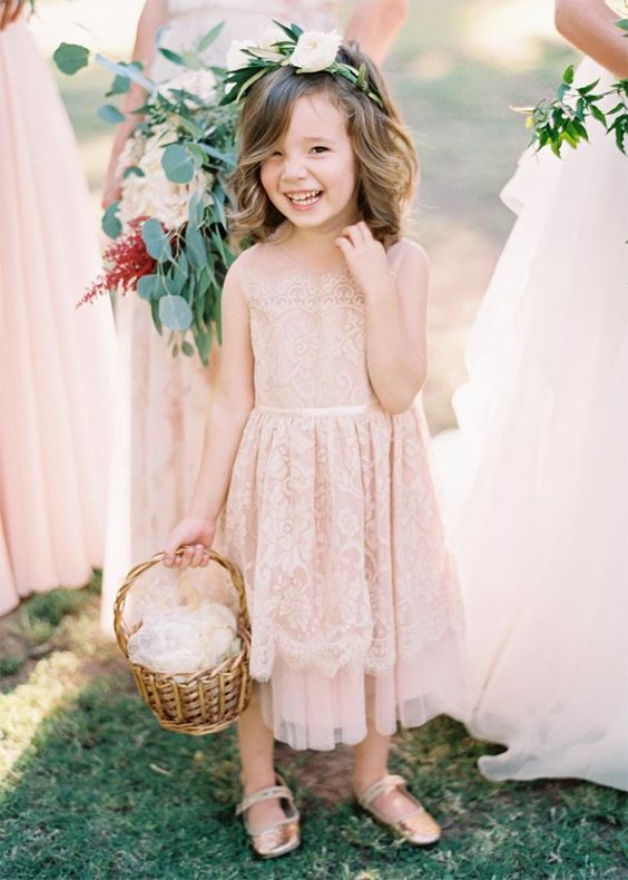 a blush sleeveless lace midi dress with a layered skirt, gold sandals and a floral crown plus a basket with petals
