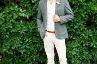 a chic and simple outfit with white pants and a shirt, a grey jacket, brown shoes and a florla boutonniere
