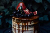 a decadent semi naked wedding cake with caramel drip, berries, pears and figs on top for fall