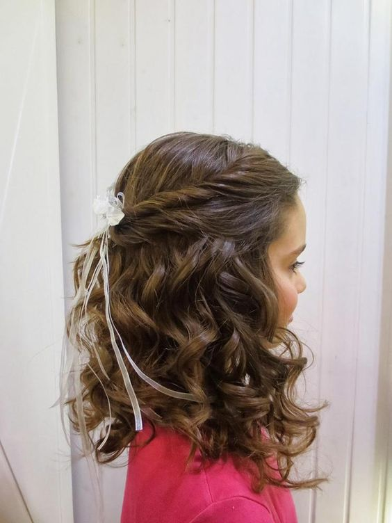 a lovely half updo with curls down, a twisted halow and a small bow headpiece is a pretty idea that will work for any style