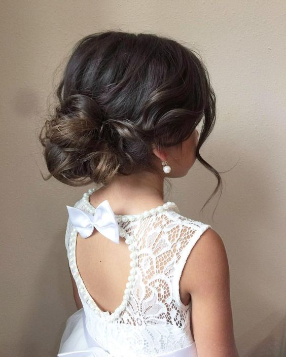 a messy low updo with waves, a volume on top and some locks down is a very chic and cool idea