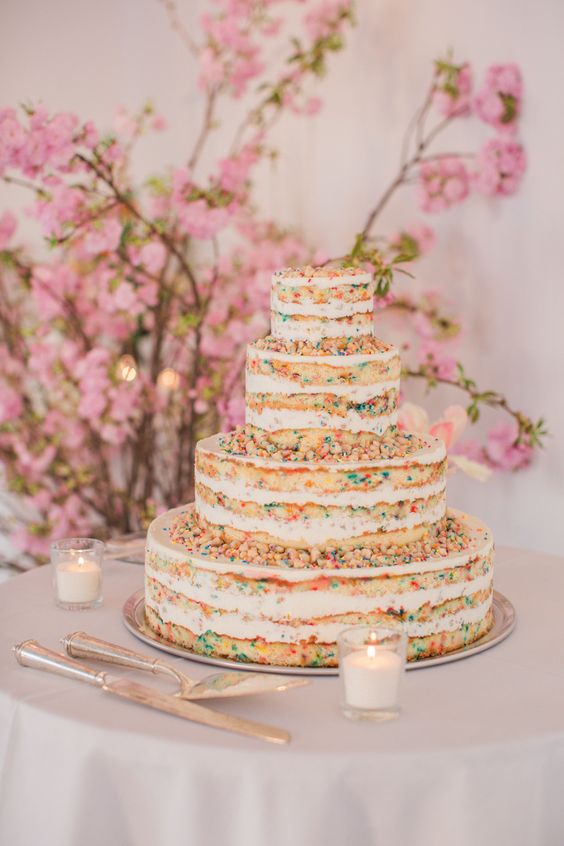 a naked sprinkle wedding cake is a very chic and fun idea of a dessert that looks very yummy