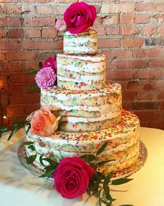 a naked sprinkle wedding cake topped with bold blooms and greenery is a chic and bold idea for a relaxed wedding