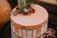 a naked wedding cake with copper drip, cacti and dried blooms on top is an amazing idea for a desert wedding