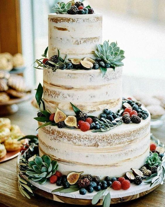 a naked wedding cake with figs, berries of all kinds, greenery and succulents is amazing for a bright summer wedding