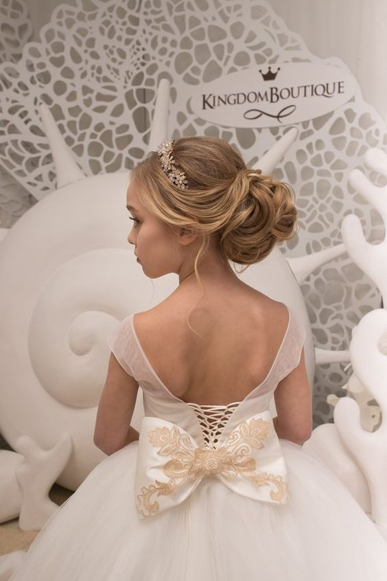 a refined and chic low bun of waves and curls, with a bump and an embellished headpiece is a beautiful solution for a formal wedding