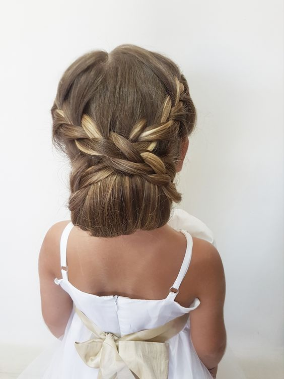a refined low bun with braids is a beautiful and sophisticated solution for a more formal wedding, and for long hair