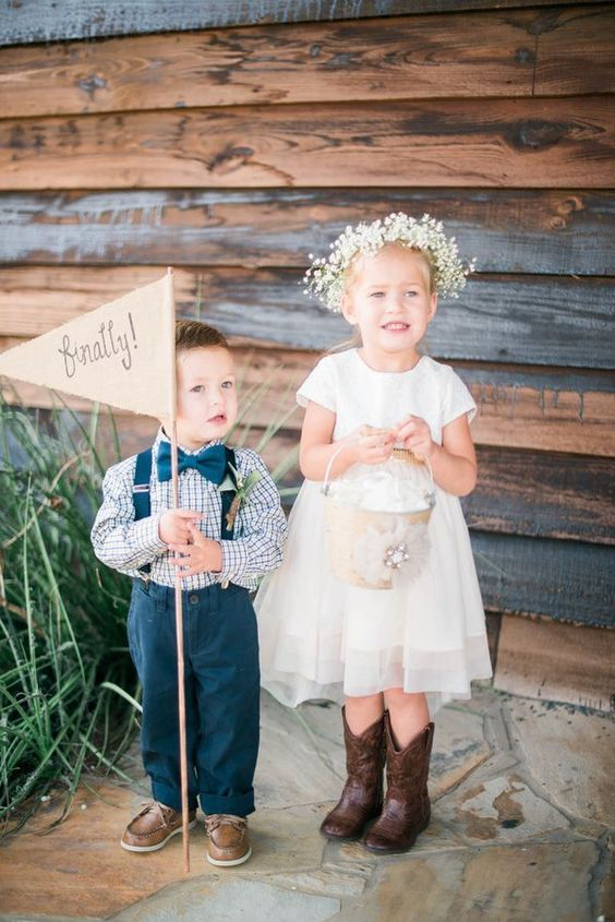 a simple white knee dress with short sleeves, a high neckline, cowboy boots and a baby's breath crown