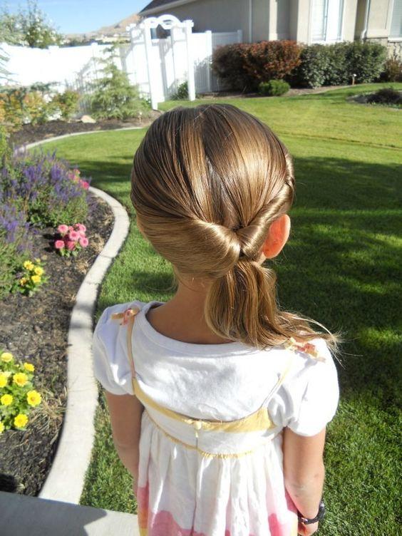 a sleek twisted low ponytail with a sleek top is a stylish idea for a modern or minimalist wedding