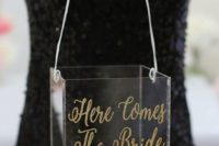 an acrylic box with a wide handle and gold calligraphy is n ultra-modern idea to rock