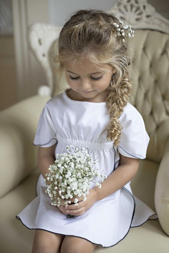 an extremely cute wavy side braid with twists, a braid on top, baby's breath for detailing and some locks down is amazing