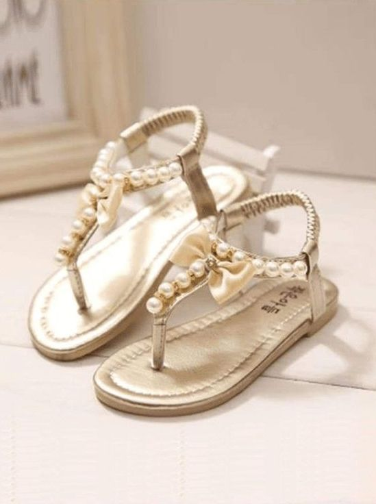flat sandals with T straps decorated with pearls and silk bows are a chic and bold idea for a summer wedding