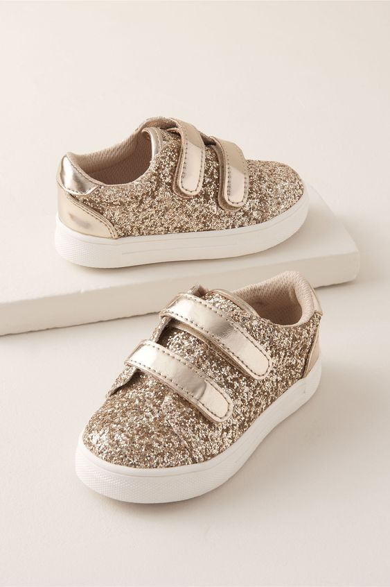 gold glitter sneakers are a nice option for a glam flower girl and for a more casual wedding