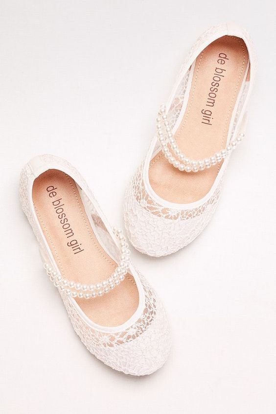 heavenly white lace flats with pearl straps are classics that will fit a formal flower girl look