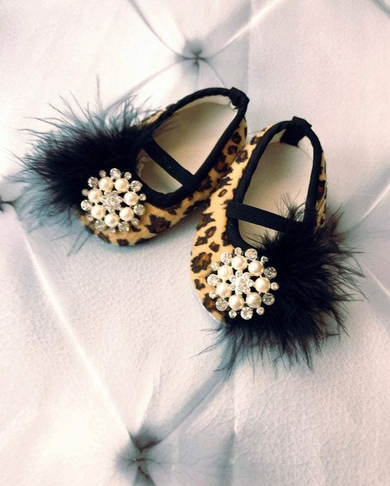 leopard flats with pearl and rhinestone embellishments and black fur look veyr glam and very trendy
