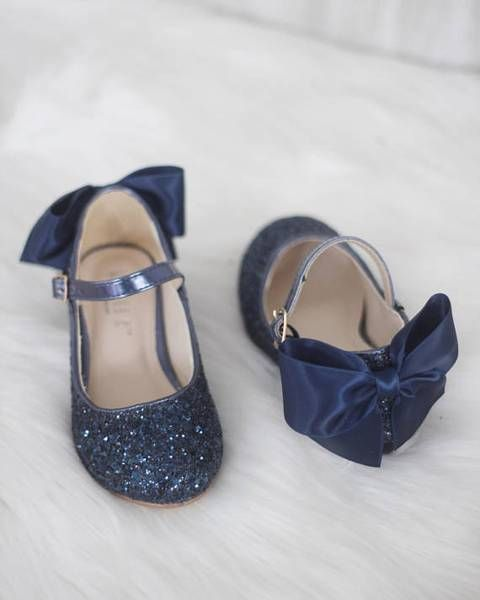 navy glitter strap flat shoes with silk bows on the backs will add color and chic to the look