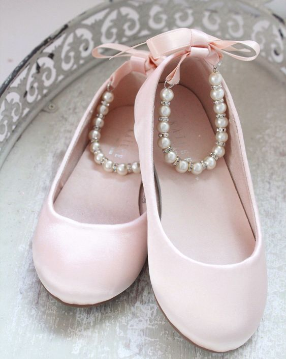 pink flats with pearl ankle straps and pink bows will add a touch of color and a girlish touch to the look