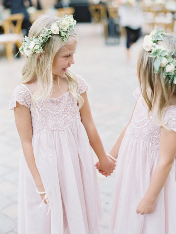 pink knee dresses with embellished lace bodices and cap sleeves plus pearl breacelets and floral crowns