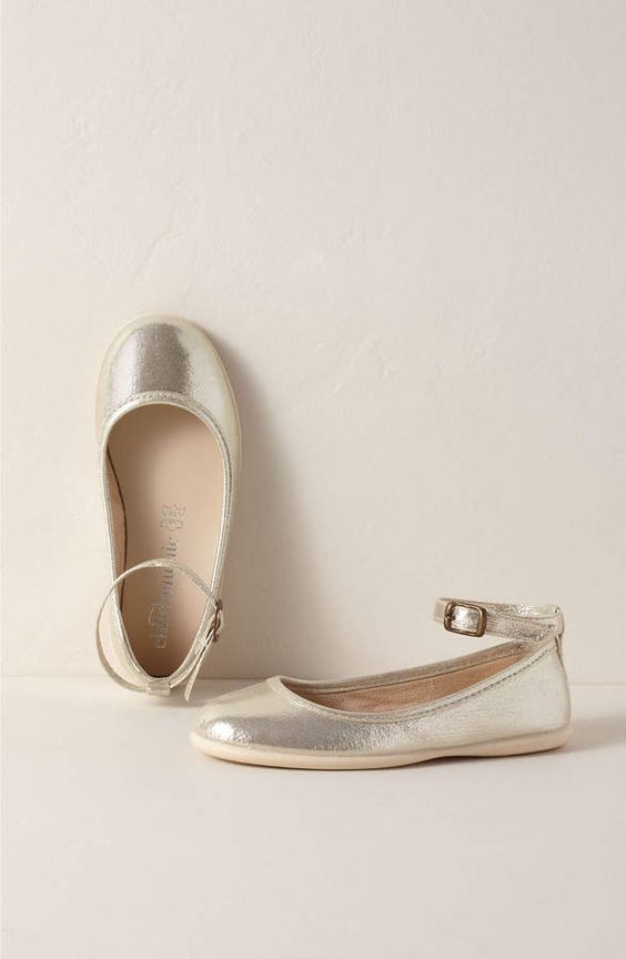 silver ankle strap flat shoes are a shiny touch to the flower girl's look