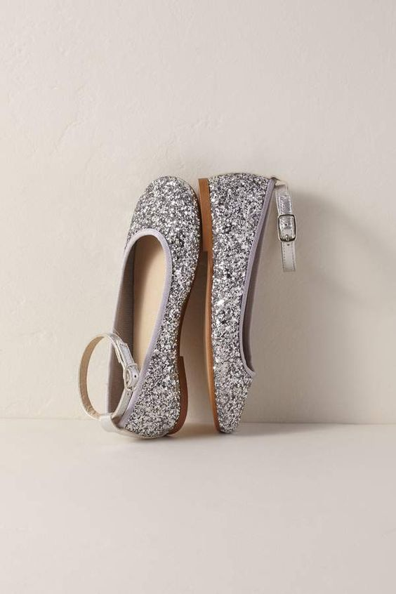 silver glitter flats with ankle straps for a shiny and bold touch to the flower girl's look