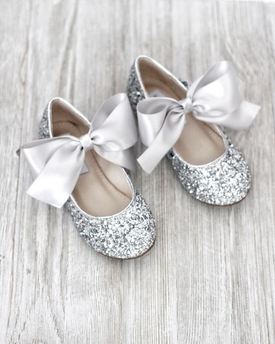 silver glitter flats with large silk bows are a nice idea for a flower girl
