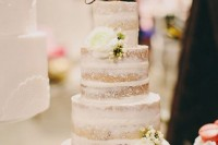 an elegant naked wedding cake with white blooms and a gold calligraphy topper will fit even a formal wedding