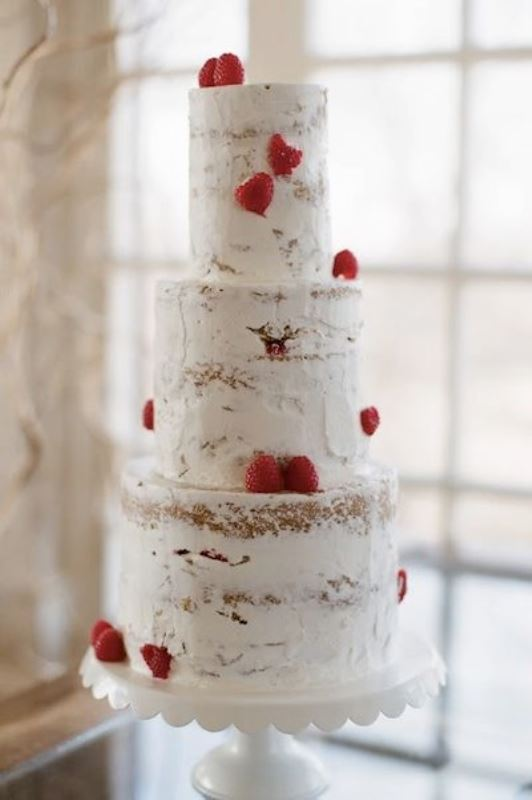 a naked wedding cake decorated with fresh strawberries for a bold contrast will easily fit any wedding