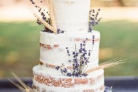 a naked wedding cake with lavender and wheat is ideal for a summer to fall or fall wedding with a rustic feel