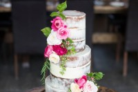 a naked wedding cake with pink and white blooms and lots of greenery is a chic idea for a bright summer wedding