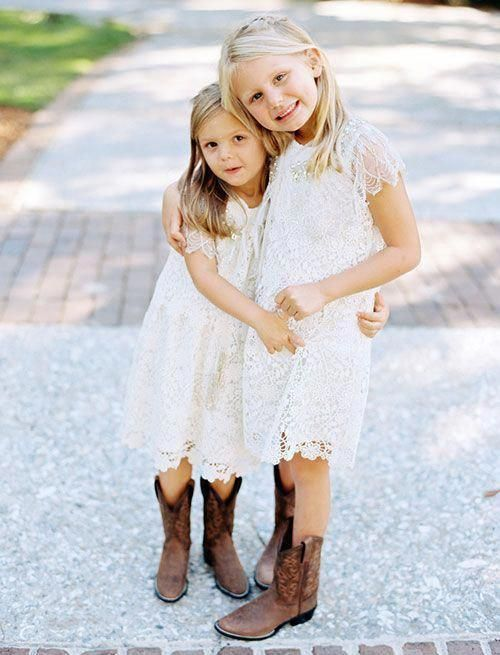 white crochet lace knee dresses with high necklines, cap sleeves and cowboy boots look cool