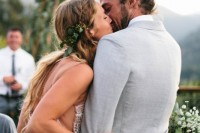 a light grey suit with a white shirt and a man bun for a relaxed and stylish summer boho groom's look