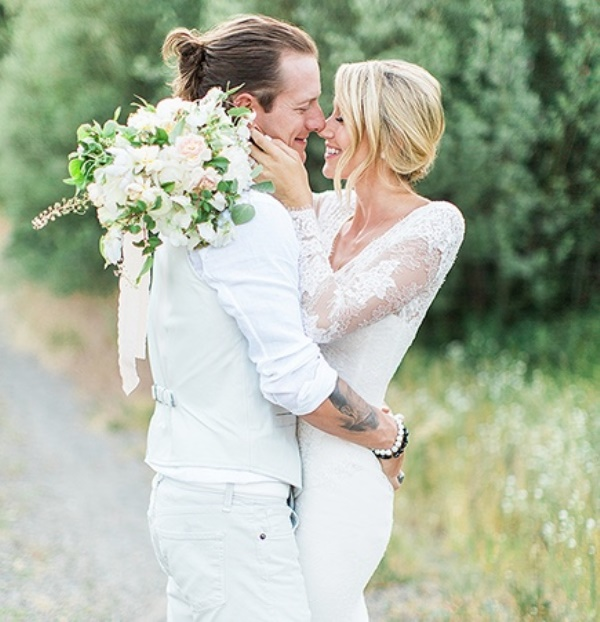 a light grey waistcoat, pants, a white shirt, a man bun for a spring or summer boho groom look