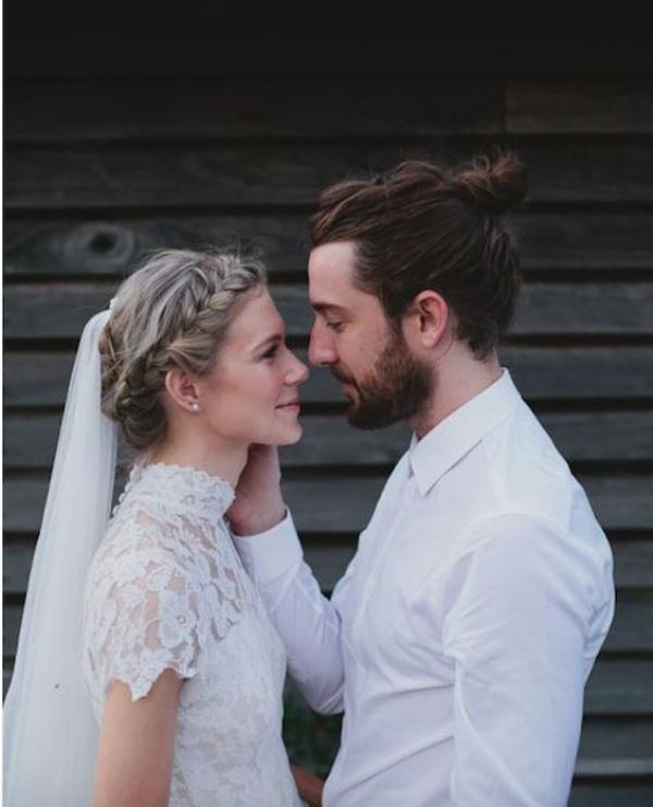 a modern boho groom's look with a white shirt, a full beard and a man bun is a great idea