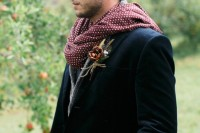 a boho groom's look with a navy velvet blazer, a grey cardigan, a polka dot scarf, navy jeans and a man bun for a lovely fall or winter boho groom's look