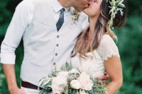 a chic groom's outfit with white pants, a white button down and a dove grey waist coat plus black details
