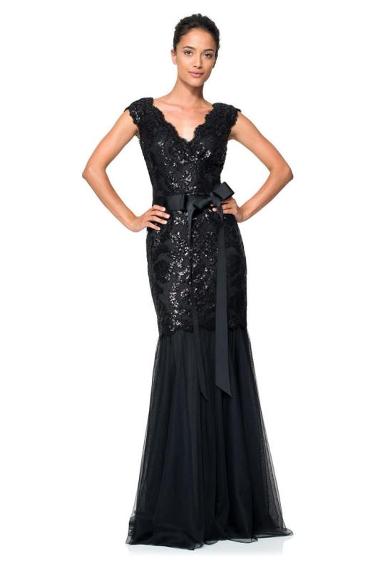 a black fittign maxi dress with an embellished bodice, thick straps, a sash and a draped skirt for a refined mother of the bride