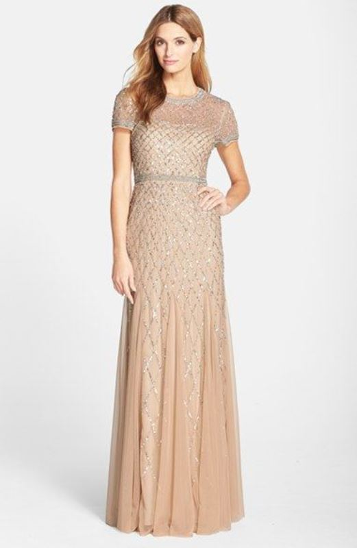 a peachy embellished gown with an illusion neckline and short sleeves looks chic and stylish