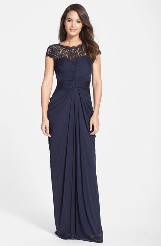 a midnight blue fittign maxi dress with a lace draped bodice, short sleeves and a draped skirt