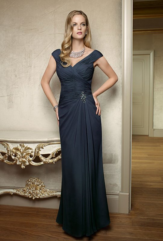 an elegant and formal deep teal maxi dress with a draped bodice and an embellishments plus a V-neckline