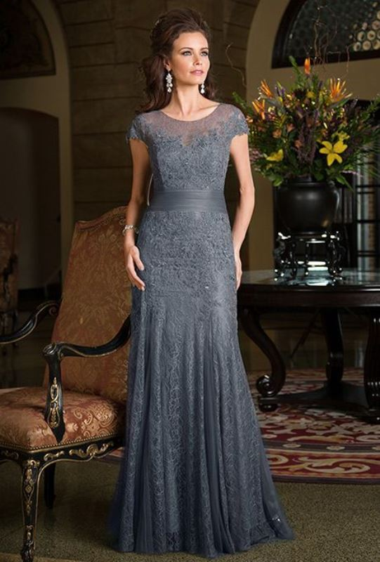a grey fitting lace dress with a high neckline, cap sleeves, plus a sash and embellishments