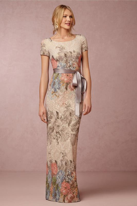 a fitting floral maxi dress with pastel embroidery, short sleeves, a high neckline and a silk grey sash