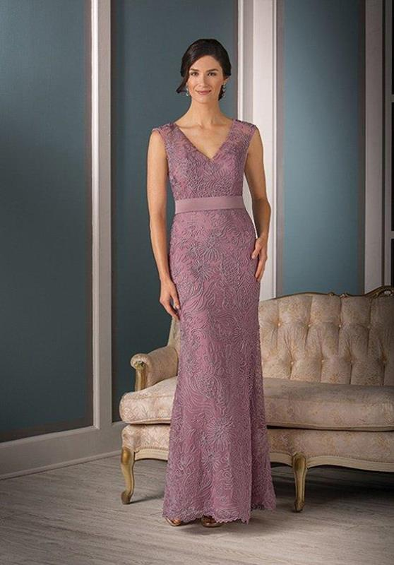 a pink lace maxi dress with thick straps and no sleeves, a V-neckline and a sash is a feminine option