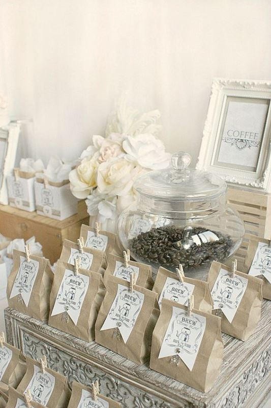 coffee beans in paper packages and with tags are amazing wedding favors that won't break the bank