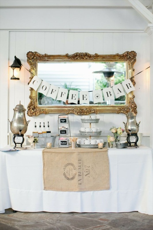 a refined vintage coffee bar with a refined mirror, silver tanks, galvanized stands and bowls for a rustic feel