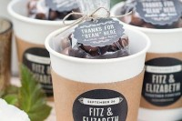 coffee cups with coffee beans and tags inside are great wedding favors for a coffee-loving couple