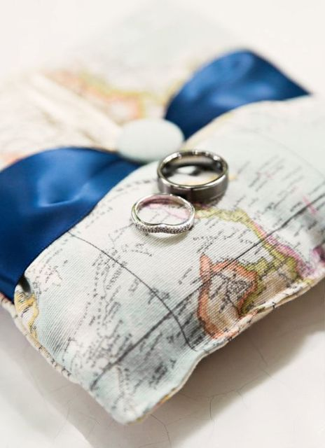a map pillow for rings is a nice alternative to a bowl and it embraces the theme of the wedding