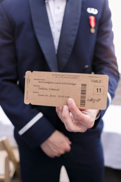 escort cards styled as plane tickets of cardboard for a travel-themed wedding